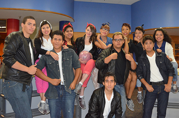 Students take a break from bowling to strike a pose in their 1950s costumes.  Photo: Gerardo Garcia