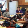 Volunteers answer phones during the biannual Sharathon.
