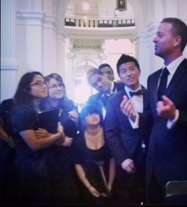 Conductor Jonathan Wall views the state rotunda with his University Singers.