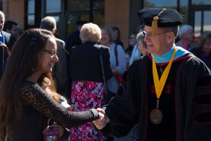 Dr. Ken Shaw greets Raquel Acevedo, freshman education major, after Inaugural Ceremony.
