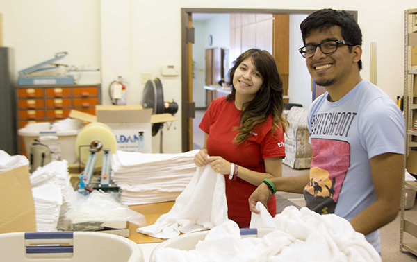 Evelyn Rubio and Isai Ramirez volunteer their time at Adventist Community Services in Keene.