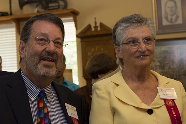 The Mendenhalls look on as well wishers greet them during the reception on April 11.