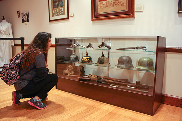 Roxana Jeter-Marin, sophomore biology major, gazes into the past while visiting the World War I exhibit at Southwestern Adventist University. Celebrating the centennial anniversary of The Great War, the exhibit opened with a reception Saturday night and will be available for public viewing until May 1 in the Meadows Gallery of the Chan Shun Centennial Library.