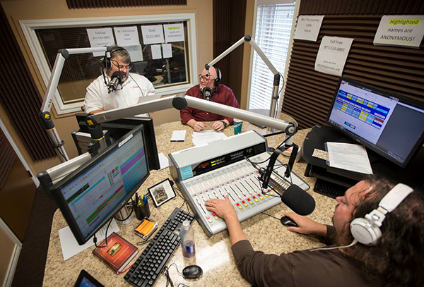 General Manager Mike Agee (far left) mans the microphones with guest host Jon Hull while Chris Gilbreth operates the board. Photo courtesy of Southwestern Baptist Theological Seminary.
