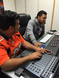Senior business major Harvey Contreras (right) tries his hands at the new editing system while Saul Flores, senior communication major, coaches him.