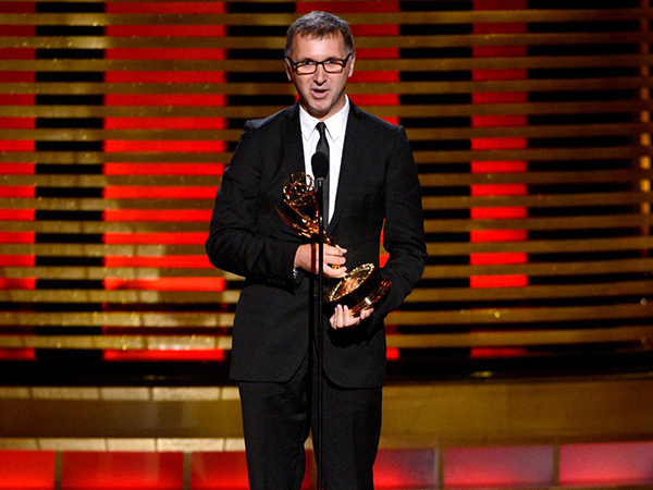 "Michael Price accepts his Emmy for work on the BBC television program ""Sherlock."" (Photo: Associated Press)"