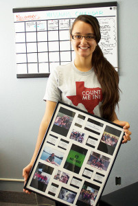 Junior Education Major Rachel Acevedo holds up a poster showing Southwestern students now serving as missionaries overseas.